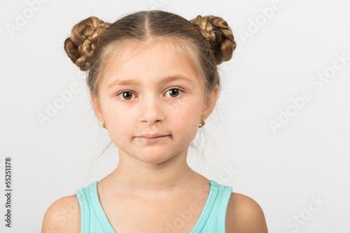 Close portrait of a girl with an interesting hairdo