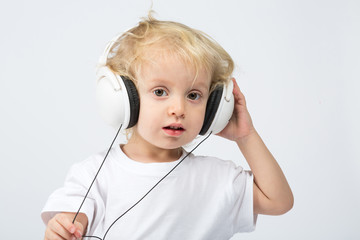Little boy with headphones listening to music