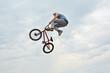 Boy jumps on bike