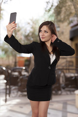 Young professional looking woman takes a self portrait with her