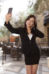 Young woman in a business attire posing for a self portrait.