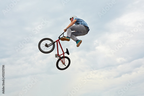 Boy jumps on bike