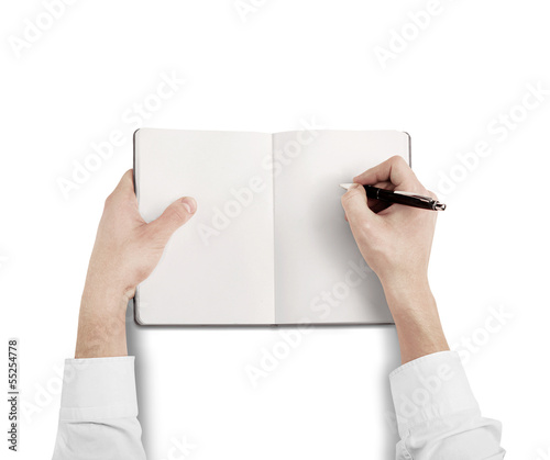hands drawing in blank notebook