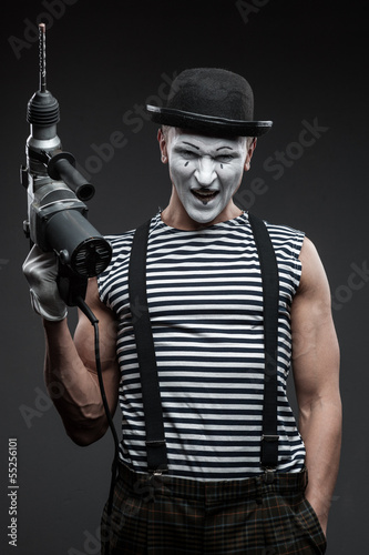 mime with hammer drill