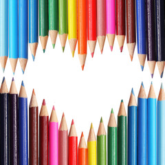Back to school concept. Colorful pencils arranged as heart.