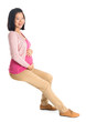 Pregnant Asian woman sitting