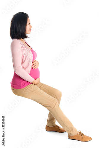 Side view pregnant Asian woman sitting