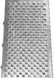 Stainless steel grater closeup.