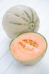 Still life fruits: cantaloupe melon, vertical shot