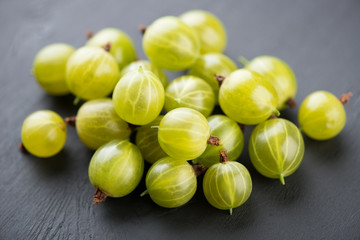 Berries: green gooseberries, studio shot