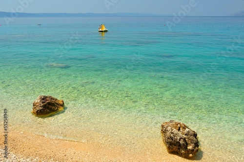 Amazing beach with two big stones near Tucepi, Croatia