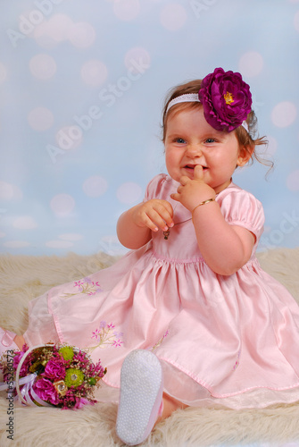 lovely little baby girl with flower