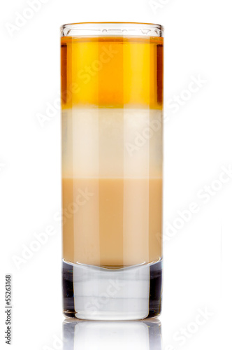 Shot three layers alcohol cocktail isolated on white