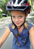 young girl with bicycle and helmet