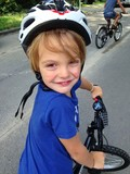 young boy with bicycle and helmet