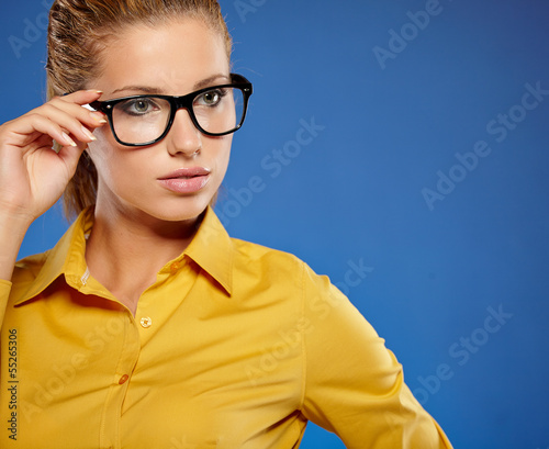 Young businesswoman on blue background