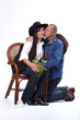 A cowboy couple kissing