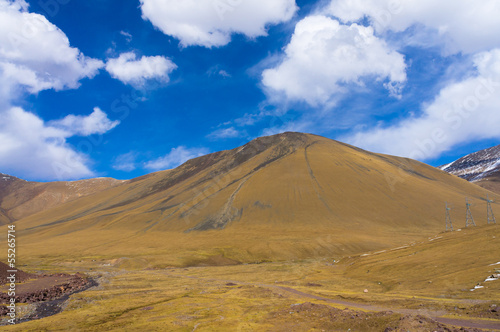Picturesque hill against the background of colourful dark blue