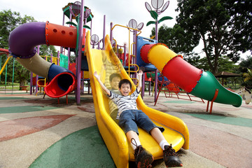 Happy boy sliding down