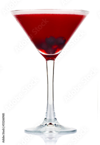 Sliced alcohol cocktail with currant berry isolated on white