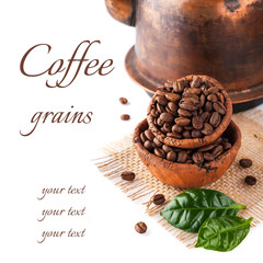 Coffee grains and green leaves on a white background