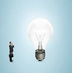 businessman looking at bulb