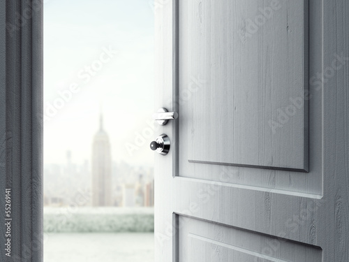 opened door in city