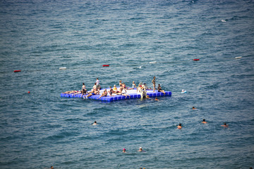 the people who is swimming at the sea