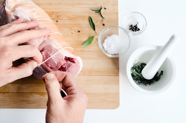 Chef hands with raw meat pork roast cooking preparation