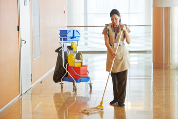 Female worker cleaning business hall