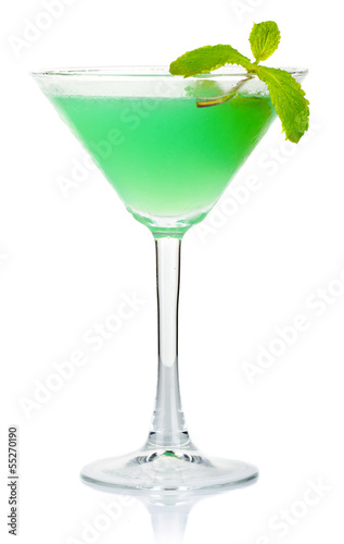 Green alcohol cocktail with fresh mint leaves isolated on white