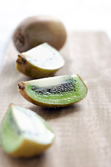Kiwi fruit on wooden board