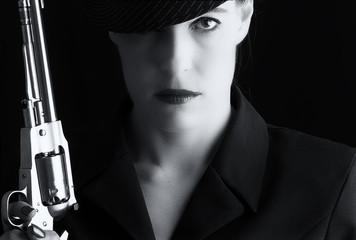 Dangerous woman in black with silver handgun
