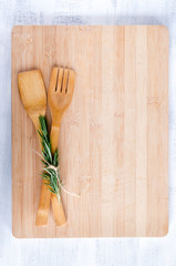 Overhead view wooden utensils on wooden board