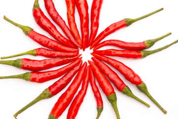 colorful hot chillies arranged circularly isolated on white back