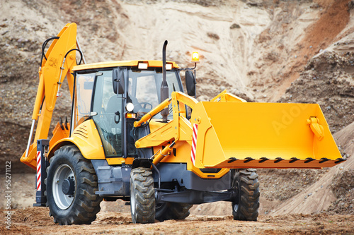 loader excavator with risen shovel