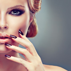 Blonde model with fashion make-up and  manicure