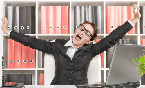 Business woman yawning
