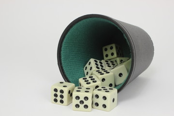 White dice with black and green dice cup - isolated