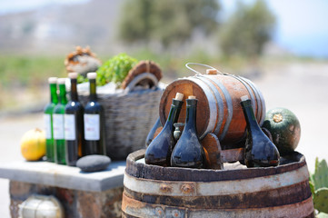 Still-life with wine bottles and barrels