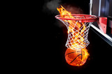 Flaming basketball going through a net