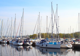 Yacht harbor in east Denamrk with forest in background
