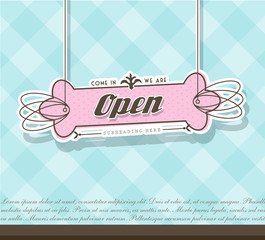 Open sign hanging on pink badge with blue background.