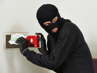 thief burglar at house safe breaking