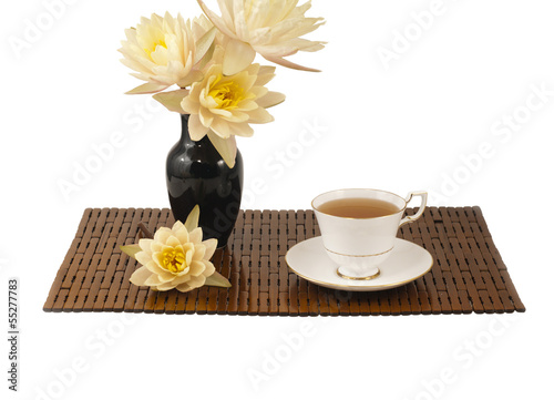 Cup of tea on bamboo mat.