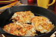 Potato latkes in a cast iron skillet
