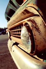 Vintage Car Headlights during Sunset