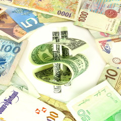 Isolated dollar bill symbol among multiple foreign currency