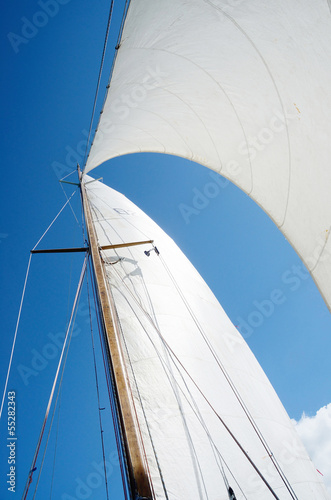 Sail and mast on yacht, view from deck of boat