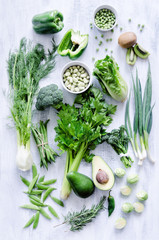Green vegetables on white rustic background
